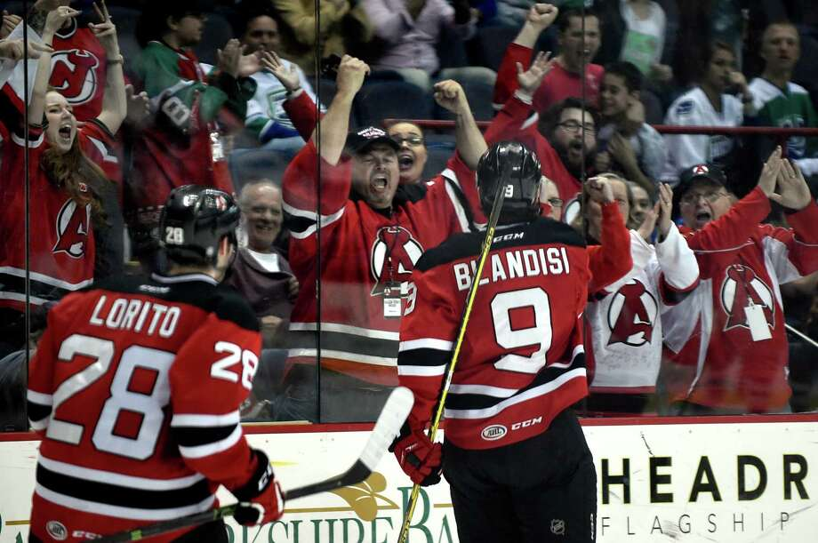 Devils' fans celebrate Joseph Blandisi's third-period goal in game one of their hockey series against the Utica Comets on Friday, April 22, 2016, at Times Union Center in Albany, N.Y. Devils win 3-2. (Cindy Schultz / Times Union) Photo: Cindy Schultz / Albany Times Union