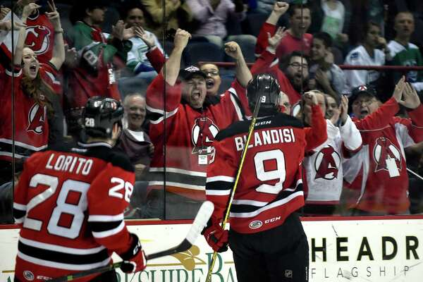Devils' fans celebrate Joseph Blandisi's third-period goal in game one of their hockey series against the Utica Comets on Friday, April 22, 2016, at Times Union Center in Albany, N.Y. Devils win 3-2. (Cindy Schultz / Times Union)