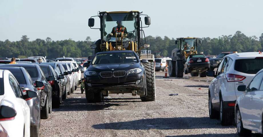 Cars are shown being moved at an auto salvage yard Friday, April 22, 2016, in Houston where many flooded cars are stored. ( Melissa Phillip / Houston Chronicle ) Photo: Melissa Phillip, Staff / © 2016 Houston Chronicle