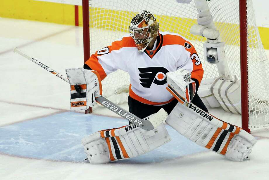 Philadelphia goalie Michal Neuvirth blocks a shot - one of 44 he stopped against Washington - in the third period of the Flyers' 2-0 victory Friday night. Photo: Alex Brandon, STF / AP