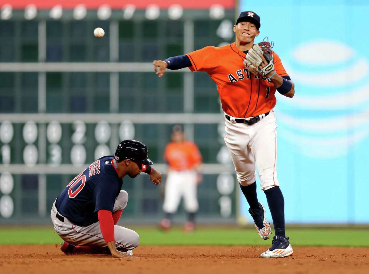 Houston Astros shortstop Carlos Correa (1) tags second forcing out Boston Red Sox left fielder Chris Young (30) turning a double play in the top of the ninth inning at Minute Maid Park Friday, April 22, 2016, in Houston, Texas.