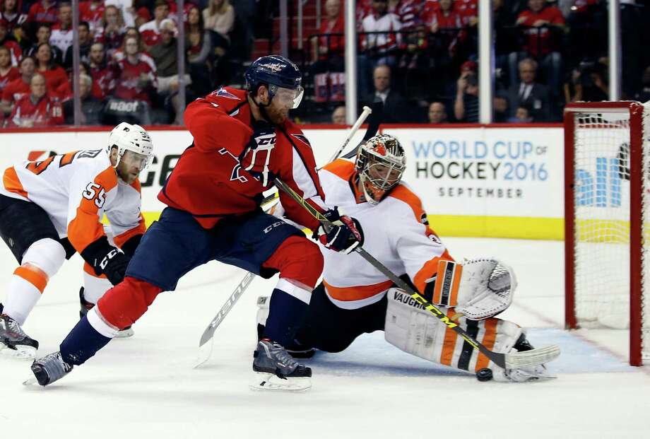 Washington Capitals defenseman Karl Alzner (27) can't score past Philadelphia Flyers goalie Michal Neuvirth (30), from the Czech Republic, during the second period of Game 5 in a first-round NHL Stanley Cup hockey playoff series, Friday, April 22, 2016, in Washington. (AP Photo/Alex Brandon) ORG XMIT: VZN106 Photo: Alex Brandon / Copyright 2016 The Associated Press. All rights reserved. This m