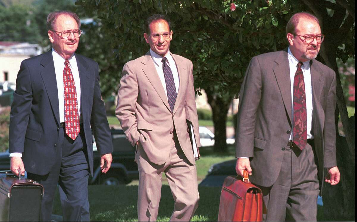 Attorneys Roy G. Minton, left, Mark D. Murr, center, and David Minton enter the Federal Courthouse in Texarkana, Texas Thursday, May 6, 1999. Murr was seeking $260 million from the state of Texas for his work with tobacco litigation but agreed today to accept a fee of $1 million. A longtime friend of former Attorney General Dan Morales, Murr had sought the fee for his role as an adviser to Morales, but other private attorneys on the tobacco case said he did little or no work on the matter. (AP Photo / Texarkana Gazette, Greg Felkins) HOUCHRON CAPTION (07/18/1999): Attorneys Roy G. Minton, from left, Mark D. Murr and David Minton enter the federal courthouse in Texarkana May 6. Murr had been seeking $260 million from the state for his work with tobacco litigation.