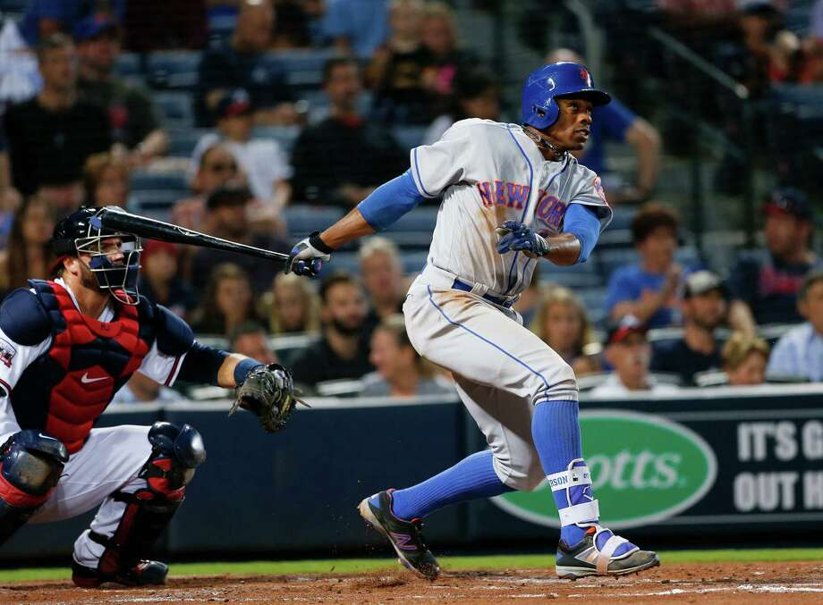 New York Mets' Curtis Granderson (3) follows through with a grand slam as Atlanta Braves catcher A.J. Pierzynski, left,  looks on in the second inning of a baseball game Friday, April 22, 2016, in Atlanta  (AP Photo/John Bazemore) ORG XMIT: GAJB112 Photo: John Bazemore / Copyright 2016 The Associated Press. All rights reserved. This m