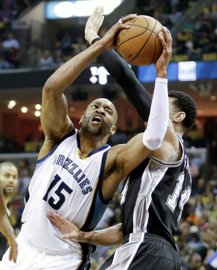 Memphis Grizzlies guard Vince Carter (15) drives against San Antonio Spurs guard Danny Green (14) in the first half of Game 3 of a first-round NBA basketball playoff series Friday, April 22, 2016, in Memphis, Tenn. (AP Photo/Mark Humphrey) Photo: Mark Humphrey, STF / Associated Press / Copyright 2016 The Associated Press. All rights reserved. This material may not be published, broadcast, rewritten or redistribu