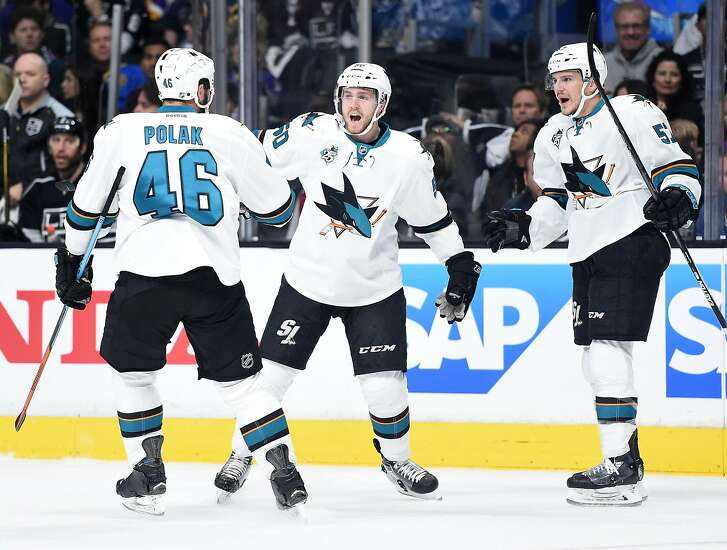 LOS ANGELES, CA - APRIL 22:  Chris Tierney #50 of the San Jose Sharks celebrates his goal with Roman Polak #46 and Tommy Wingels #57 to take a 2-0 lead over the Los Angeles Kings during the first period of Game Five of the Western Conference First Round in the 2015 NHL Stanley Cup Playoffs at Staples Center on April 22, 2016 in Los Angeles, California.  (Photo by Harry How/Getty Images)