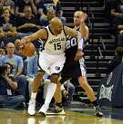 MEMPHIS, TN - APRIL 22:  Vince Carter #15 of the Memphis Grizzlies is defended by Manu Ginobili #20 of the San Antonio Spurs during the second half of game three of the Western Conference Quarterfinals during the 2016 NBA Playoffs between the San Antonio Spurs and the Memphis Grizzlies at FedExForum on April 22, 2016 in Memphis, Tennessee. NOTE TO USER: User expressly acknowledges and agrees that, by downloading and or using this photograph, User is consenting to the terms and conditions of the Getty Images License Agreement.