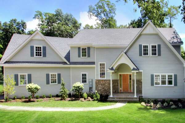 The property at 161 Butternut Lane is on the market for $1,495,000. The Colonial offers 4,319 square feet of living space on the main two floors, with an additional 1,281 square feet in the finished walk-out basement.