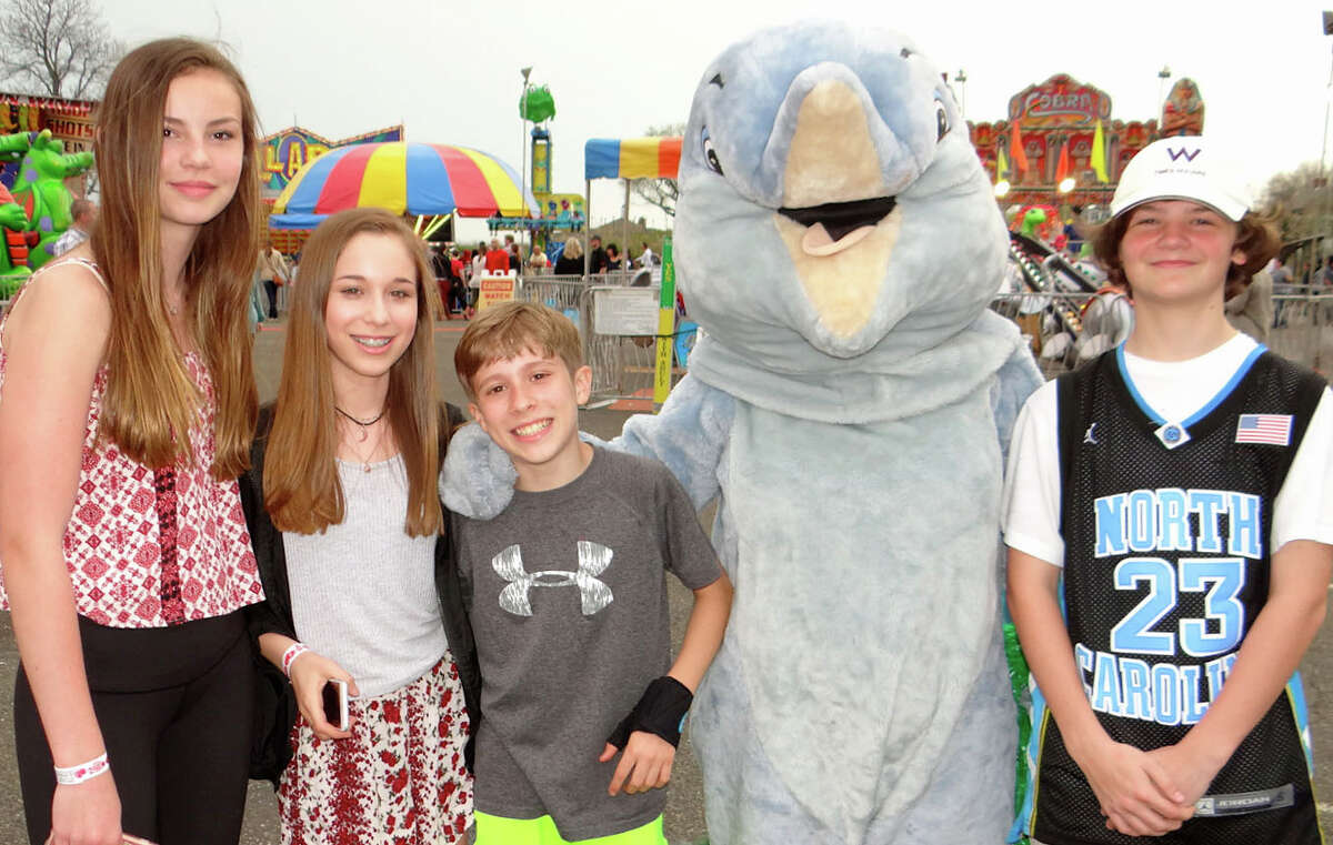 Jackie Soderlund, 13; Lauren Bratton, 13; Alex Bratton, 11, and Conner Wheeler, 14, meet Hope the McKinley mascot at the Jennings Beach carnival.