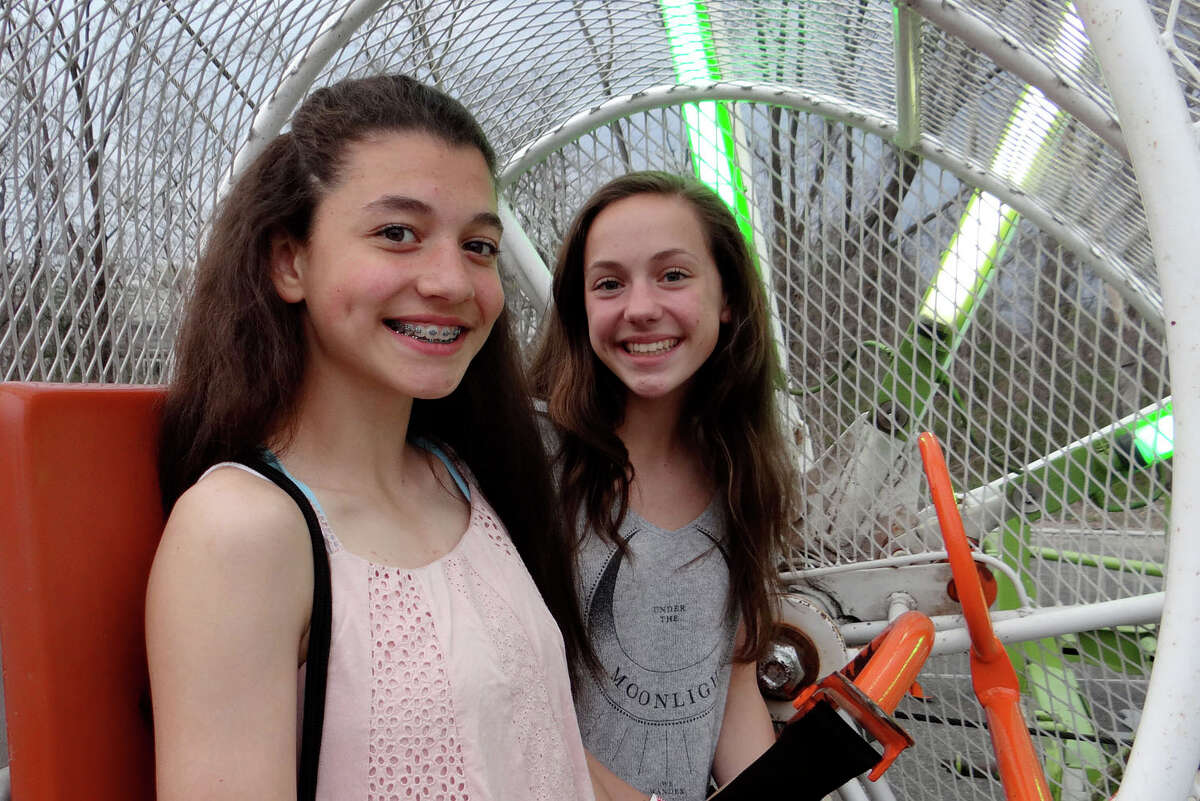 Ready to ride the Rock-O-Plane at the McKinley Carnival were Maddie Fried and Maddie Baldwin.