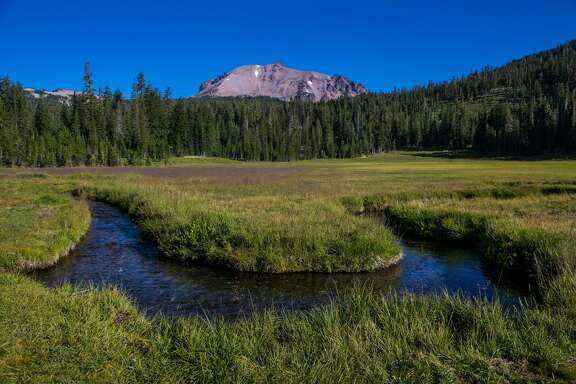 MT. LASSEN, CA - JULY 20: A creek flowing through a meadow on the slopes of Mt. Lassen, an active volcano that last erupted in 1915, is viewed on July 20, 2015, in Mt. Lassen National Park, California. After entering the fourth year of drought, reservoirs continue to flucuate at low levels, Governor Jerry 'Edmund' Brown has declared a 'mandatory reduction' on water useage for all of California.