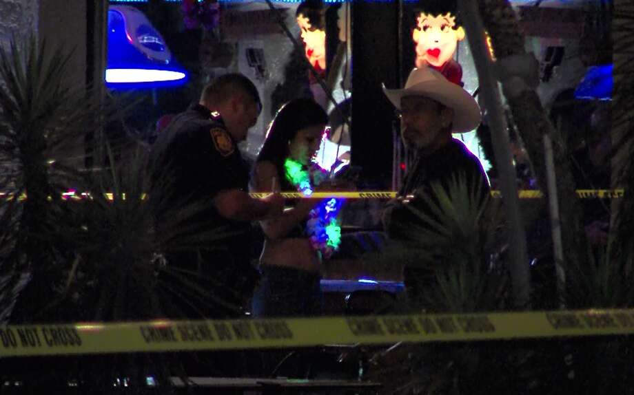 San Antonio police investigate the scene of a shooting at a bar on the North Side Saturday morning, April 23, 2016. Photo: Courtesy Pro 21 Video, For MySA.com