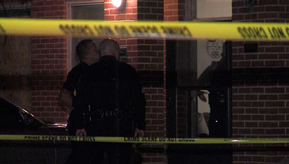 San Antonio police investigate a shooting at a party on the East Side that left a woman in critical condition Saturday, April 23, 2016. Photo: Courtesy Pro 21 Video, For MySA.com