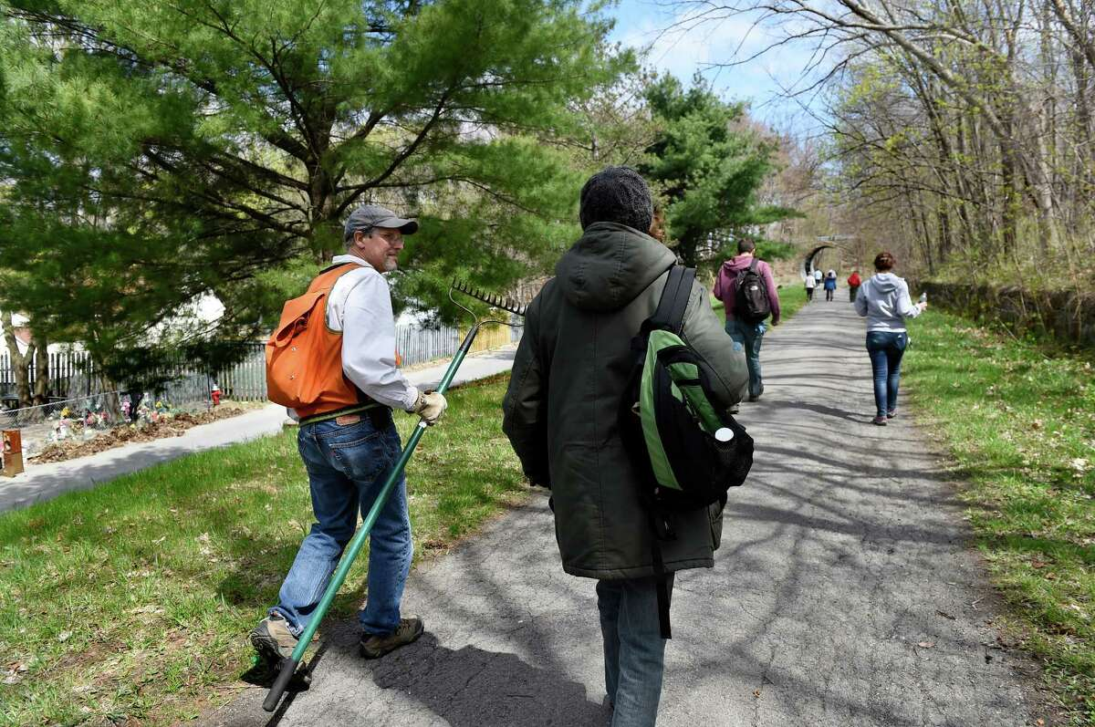 Karl Beard of National Park Rivers and Trails, left, walks along the Uncle Sam Bikeway with Theresa