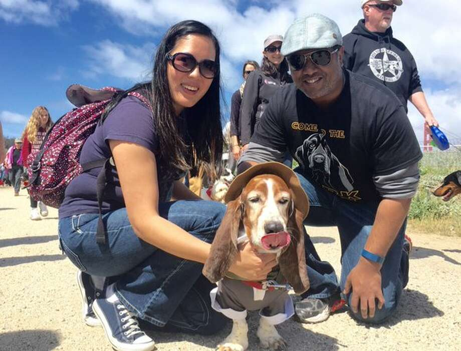 Dog owners Amy and Prince from Half Moon Bay pose with their dog Wellington at the Mighty Mutt March in San Francisco on Saturday April 23, 2016. Photo: Kevin Schultz/ The San Francisco Chronicle