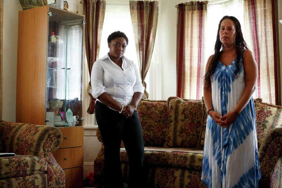 Cerrissa Harrell, the sister of Samuel Harrell, who died while imprisoned at Fishkill Correctional Facility in Beacon in April, with his wife, Diane in Kingston, N.Y., July 27, 2015. After Harrell's death at Fishkill, officials have for weeks refused to comment on inmates' accounts of a beating. The corrections officers' union has blamed the death on a drug overdose. (Richard Perry/The New York Times) ORG XMIT: XNYT1 Photo: RICHARD PERRY / NYTNS