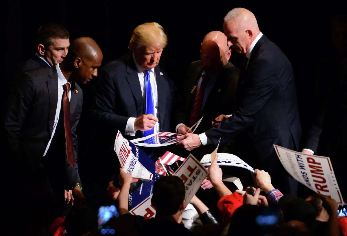 Presidential candidate Donald Trump signs autographs for supporters during a rally at the Klein Memorial Auditorium in Bridgeport, Conn., on Saturday Apr. 23, 2016.