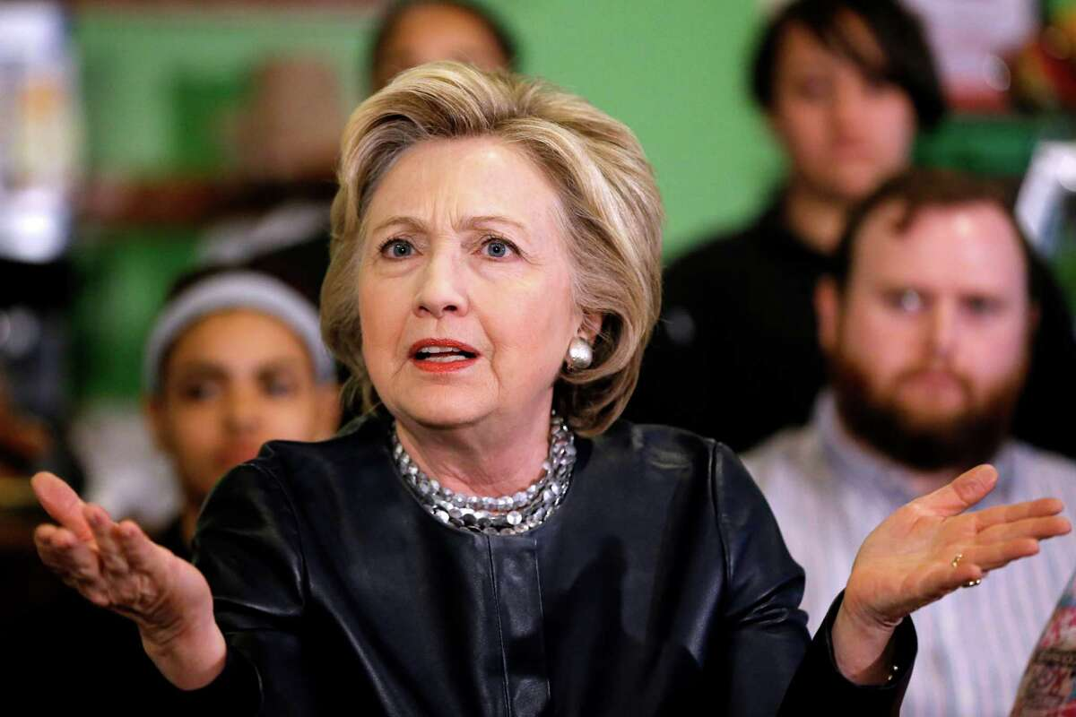 Democratic presidential candidate Hillary Clinton takes part in a discussion during a campaign stop, Saturday, April 23, 2016, at the Orangeside On Temple cafe in New Haven, Conn.