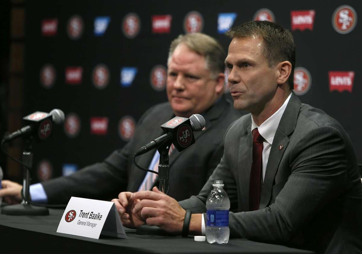 General manager Trent Baalke (right) responds to questions from reporters after introducing Chip Kelly as the new head coach of the San Francisco 49ers at a news conference at Levi's Stadium in Santa Clara, Calif. on Wednesday, Jan. 20, 2016.