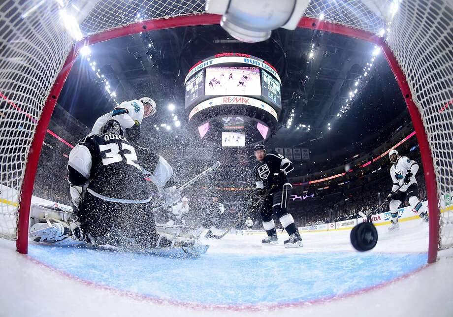 Logan Couture screens Kings goalie Jonathan Quick as a shot from Joonas Donskoi sails into the net to give the Sharks a 1-0 lead in Game 5, the series clincher, on Friday night. Photo: Harry How, Getty Images