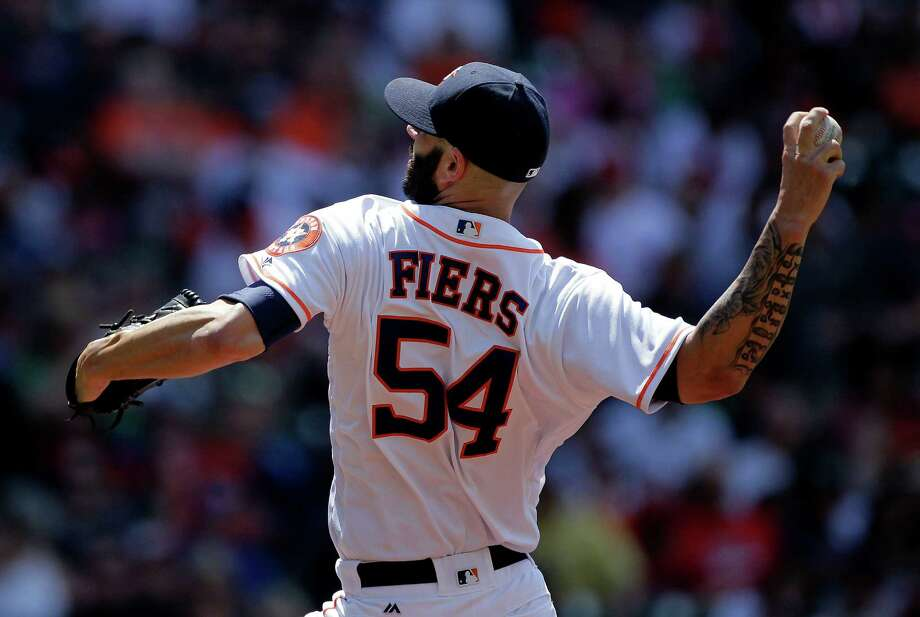 Houston Astros starting pitcher Mike Fiers (54) throws a pitch in the first inning against Boston Red Sox right fielder Mookie Betts (50). Photos of the Houston Astros second game against Boston Red Sox in a three-game series on Saturday, April 23, 2016, in Houston. Photo: Elizabeth Conley, Houston Chronicle / © 2016 Houston Chronicle