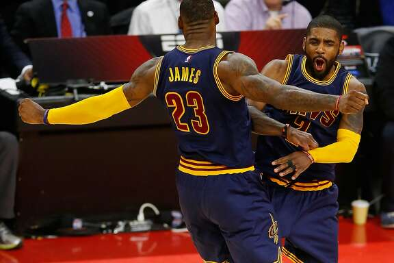 AUBURN HILLS, MI - April 22: Kyrie Irving #2 of the Cleveland Cavaliers celebrates his late fourth quarter three pointer with LeBron James #23 while playing the Detroit Pistons in game three of the NBA Eastern Conference quarterfinals at the Palace of Auburn Hills on April 22, 2016 in Auburn Hills, Michigan. NOTE TO USER: User expressly acknowledges and agrees that, by downloading and or using this photograph, User is consenting to the terms and conditions of the Getty Images License Agreement.  (Photo by Gregory Shamus/Getty Images)
