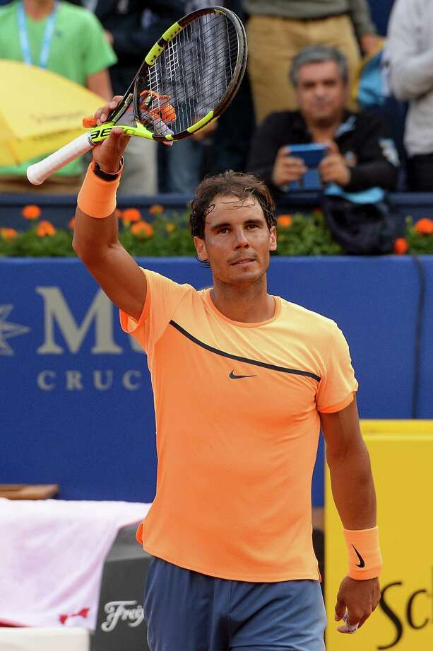"Spanish tennis player Rafael Nadal celebrates after winning against German tennis player Philipp Kohlschreiber during the ATP Barcelona Open ""Conde de Godo"" tennis tournament in Barcelona on April 23, 2016. Nadal won 6-3, 6-3. / AFP PHOTO / JOSEP LAGOJOSEP LAGO/AFP/Getty Images Photo: JOSEP LAGO / AFP or licensors"