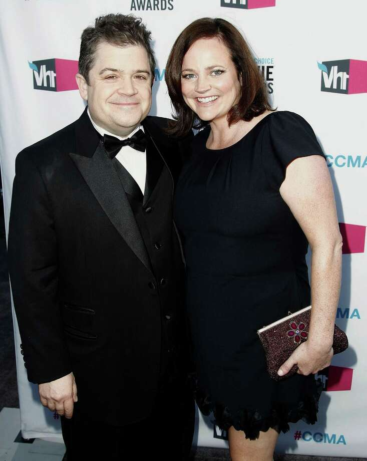FILE - In this Jan. 12, 2012 file photo, Patton Oswalt, left, and his wife Michelle Eileen McNamara arrive at the 17th Annual Critics' Choice Movie Awards in Los Angeles. McNamara, a crime writer and wife of comedian and actor Patton Oswalt, has died, according to a publicist for Oswalt. She was 46. (AP Photo/Matt Sayles, File) ORG XMIT: NYET575 Photo: Matt Sayles / AP