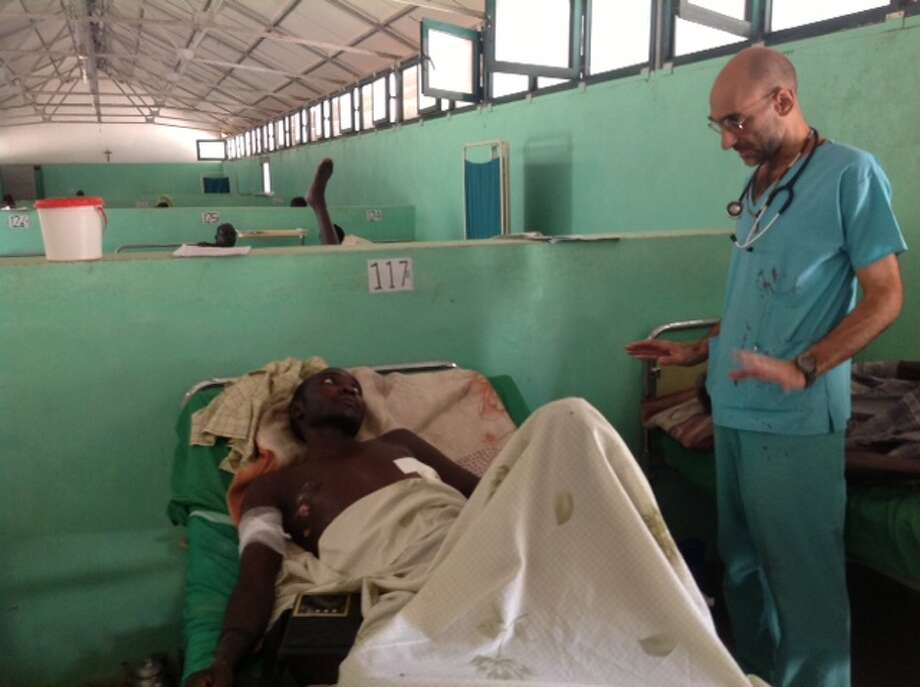 Dr. Tom Catena checks on a patient at a hospital in Sudan. The Amsterdam native was named by Time magazine in April as one of the 100 most