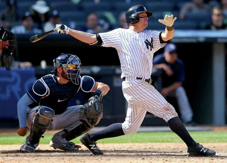 NEW YORK, NY - APRIL 23:  Brett Gardner #11 of the New York Yankees hits a solo home run as Curt Casali #19 of the Tampa Bay Rays defends in the bottom of the ninth inning to win the game against the Tampa Bay Rays at Yankee Stadium on April 23, 2016 in the Bronx borough of New York City.The New York Yankees defeated the Tampa Bay Rays 3-2.  (Photo by Elsa/Getty Images) ORG XMIT: 607676249 Photo: Elsa / 2016 Getty Images