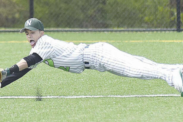 Norwalk's Kyle Mossop makes a diving stop on a ground ball out during the seventh inning of Saturday non-conference game against Fairfield Prep at the Nathan Hale Middle School field. Prep won the game, 4-0.
