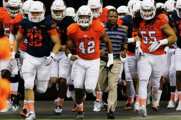 New head football coach Frank Wilson (second from right) runs out with the players during the UTSA Spring Game at the Alamodome on Saturday, Apr. 23, 2016. (Kin Man Hui/San Antonio Express-News)