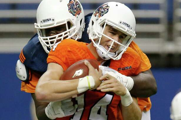Defensive tackle Vontrell King-Williams gets a sack on quarterback Dalton Sturm (14) during the UTSA spring game at the Alamodome on April 23, 2016.