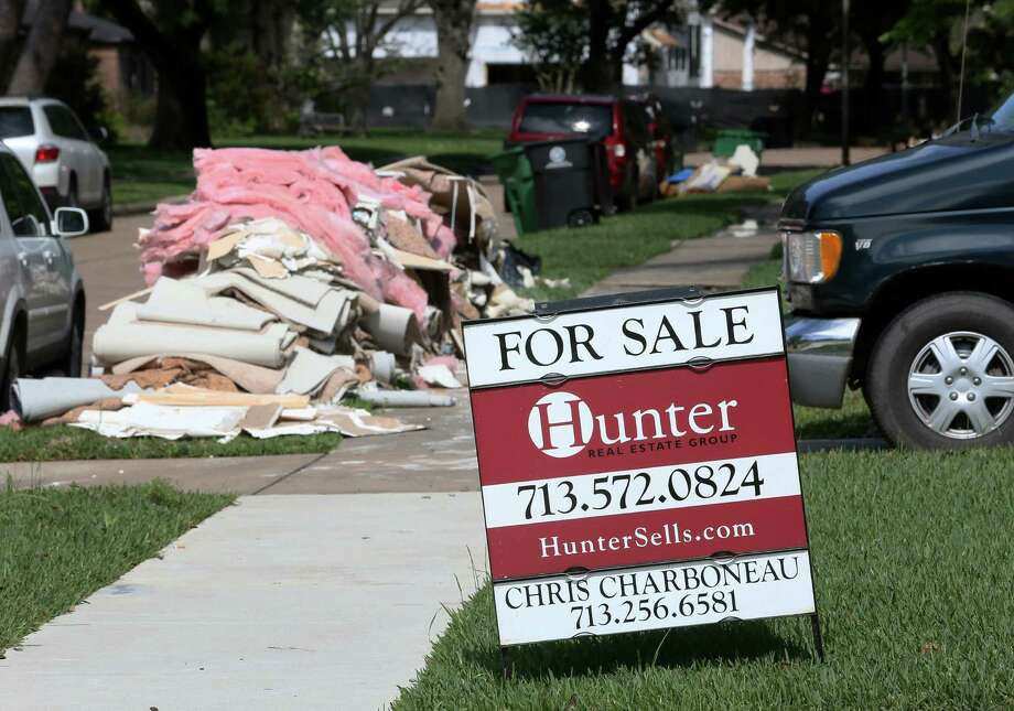 Saturday, April 23: Debris is piled outside a Meyerland home after the area flooded for the second time in 11 months. Photo: Jon Shapley, Staff / © 2015  Houston Chronicle