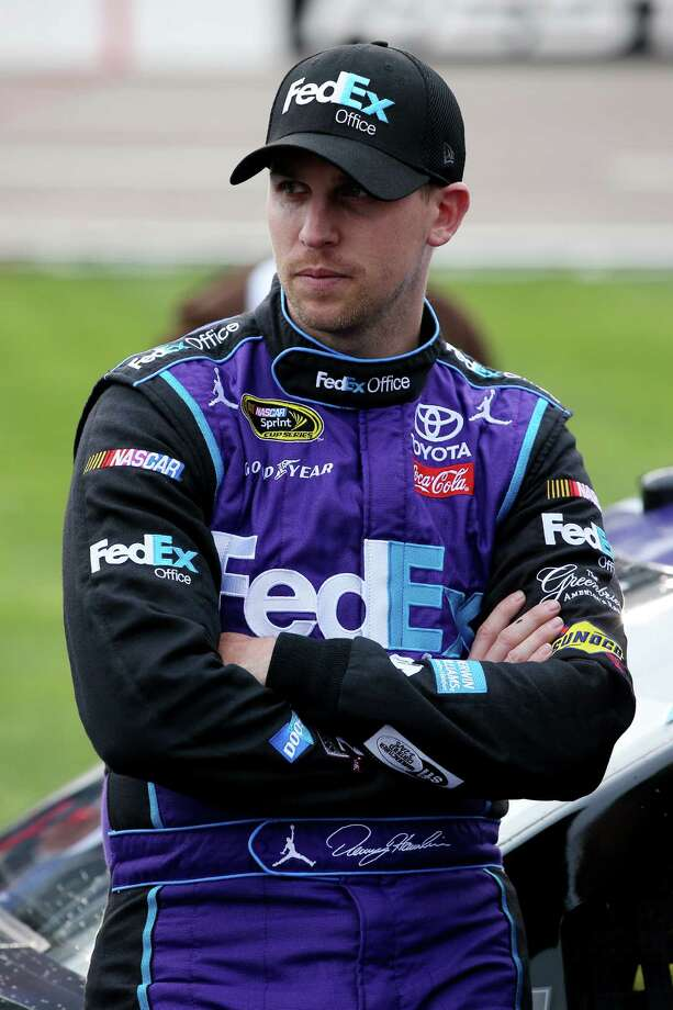 FORT WORTH, TEXAS - APRIL 09:  Denny Hamlin, driver of the #11 FedEx Office Toyota, stands on the grid prior to the NASCAR Sprint Cup Series Duck Commander 500 at Texas Motor Speedway on April 9, 2016 in Fort Worth, Texas.  (Photo by Sean Gardner/Getty Images) ORG XMIT: 627550845 Photo: Sean Gardner / 2016 Getty Images