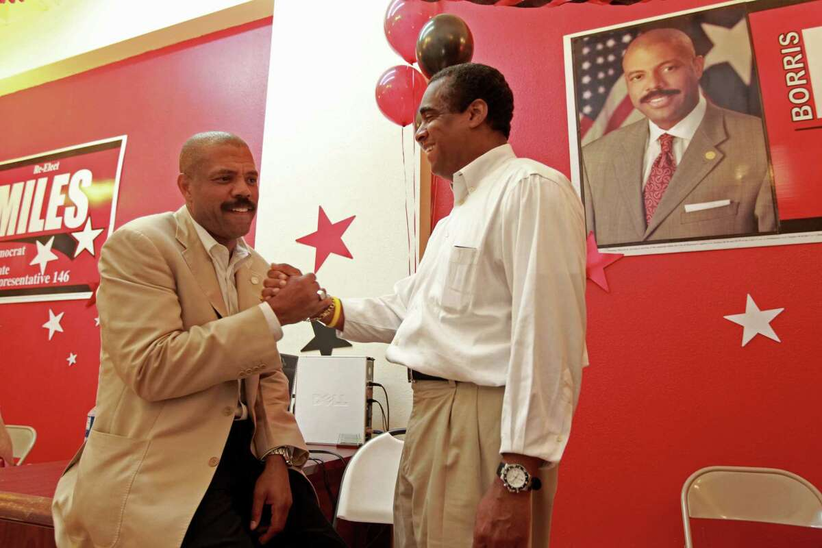 State Rep. Borris Miles, left, celebrates his victory in 2012 with his financial chair, Theldon Branch, at his election night watch party in Houston. Miles' stake in a hospice agency came to light when he filed a lawsuit in 2014 against his business partners.