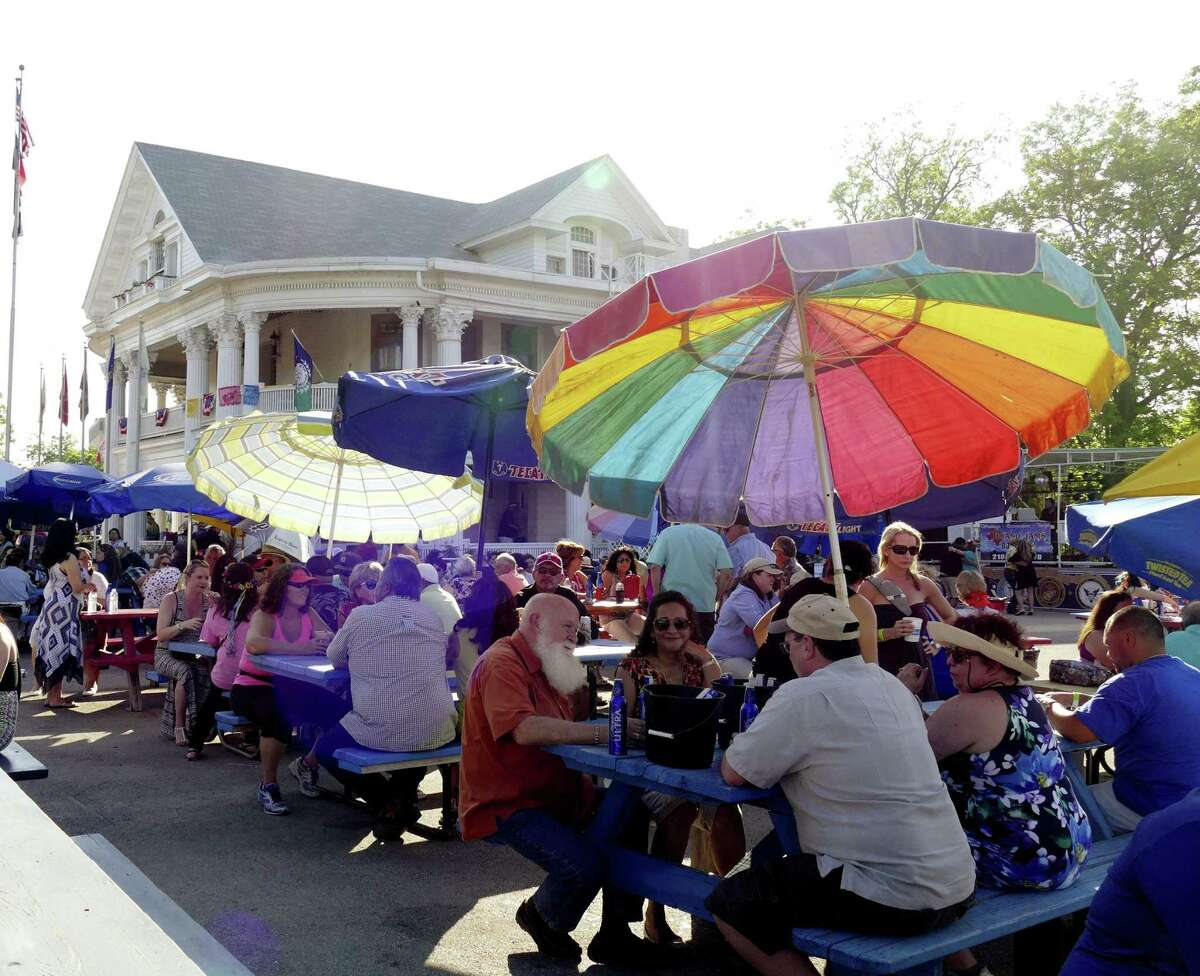 People enjoy themselves during the 10th Street River Festival at VFW Post 76 in 2016. The official Fiesta event raises funds to be used for upkeep of the 19th-century mansion that houses the organization and for veterans programs.