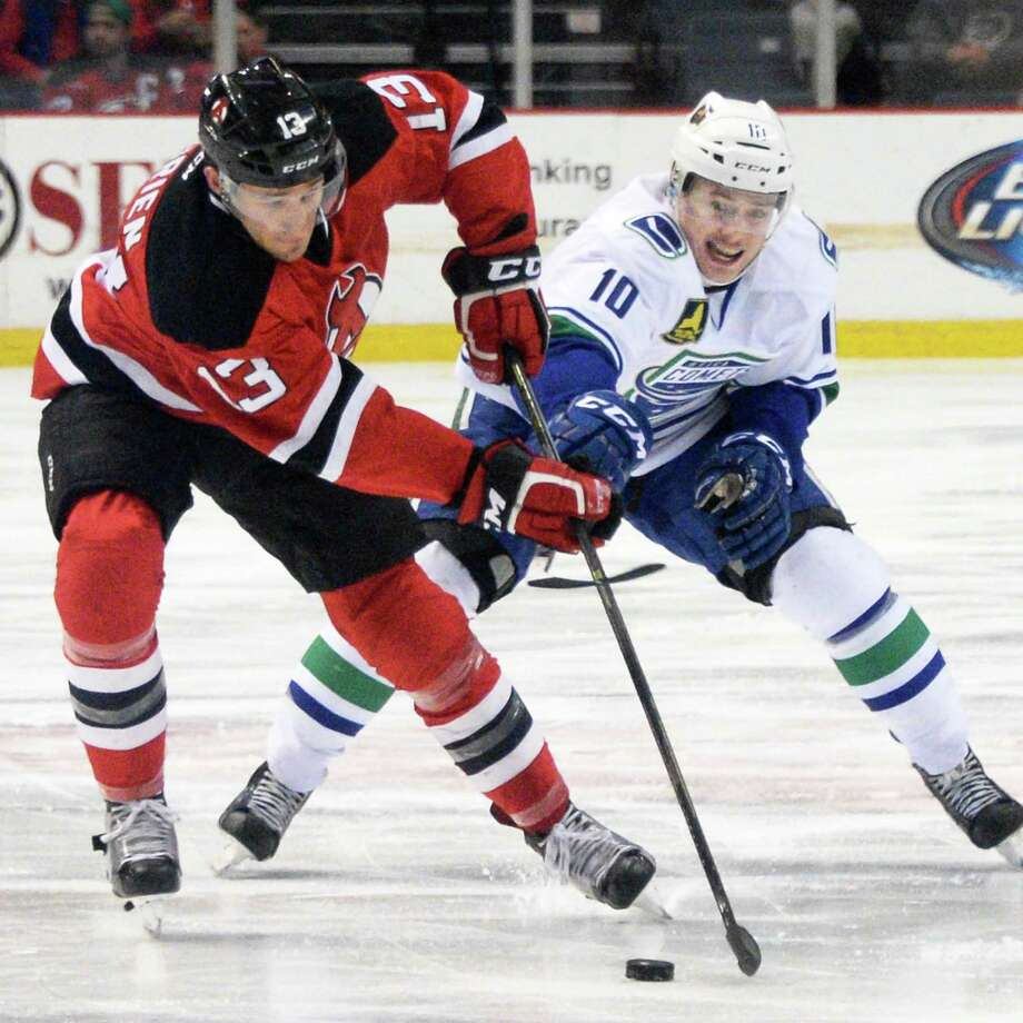 Albany Devils' #13 Jim O'Brien, left, and Utica Comets' #10 Brendan Gaunce battle it out during Game 2 of their playoff series sat the Times Union Center Saturday April 23, 2016 in Albany, NY.  (John Carl D'Annibale / Times Union) Photo: John Carl D'Annibale / 10036241A