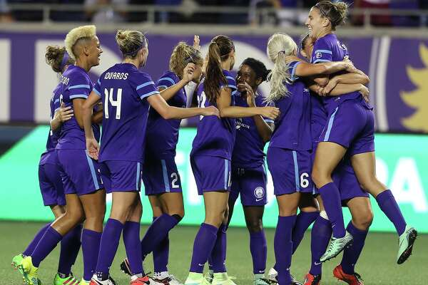 Orlando players celebrate after Alex Morgan scored a goal during the Houston Dash at Orlando Pride women's soccer game at the Orlando Citrus Bowl on Saturday, April 23, 2016.