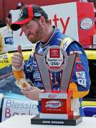 It's all good for Dale Earnhardt Jr. as he takes a bite out of a mayonnaise and banana sandwich after winning Saturday's Xfinity race.