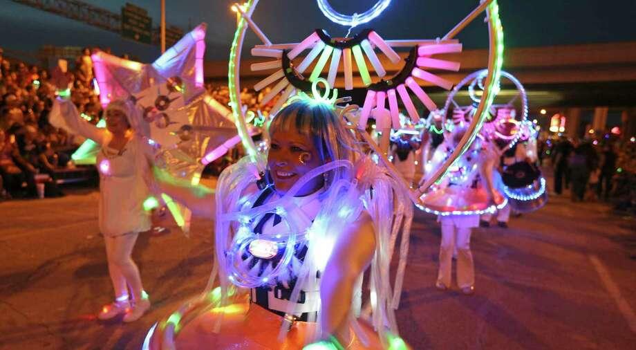 Silvia Maldonado of Urban-15 performs with the group during the 2016 Fiesta Flambeau Parade held Saturday April 23, 2016. Photo: Edward A. Ornelas, Staff / San Antonio Express-News / © 2016 San Antonio Express-News