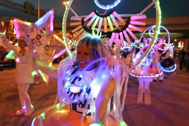Silvia Maldonado of Urban-15 performs with the group during the 2016 Fiesta Flambeau Parade held Saturday April 23, 2016.