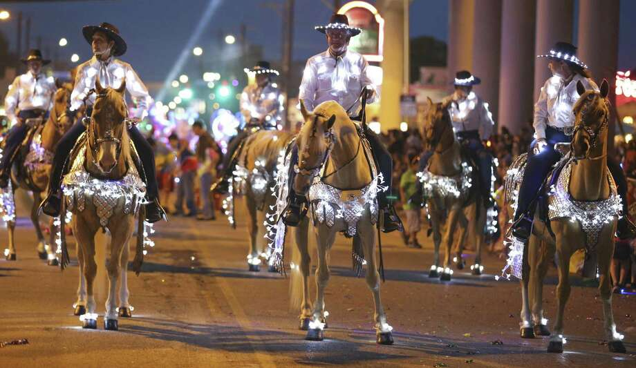 The Texas Heritage Riders were part of last year's Fiesta Flambeau Parade. Photo: Edward A. Ornelas /San Antonio Express-News / © 2016 San Antonio Express-News