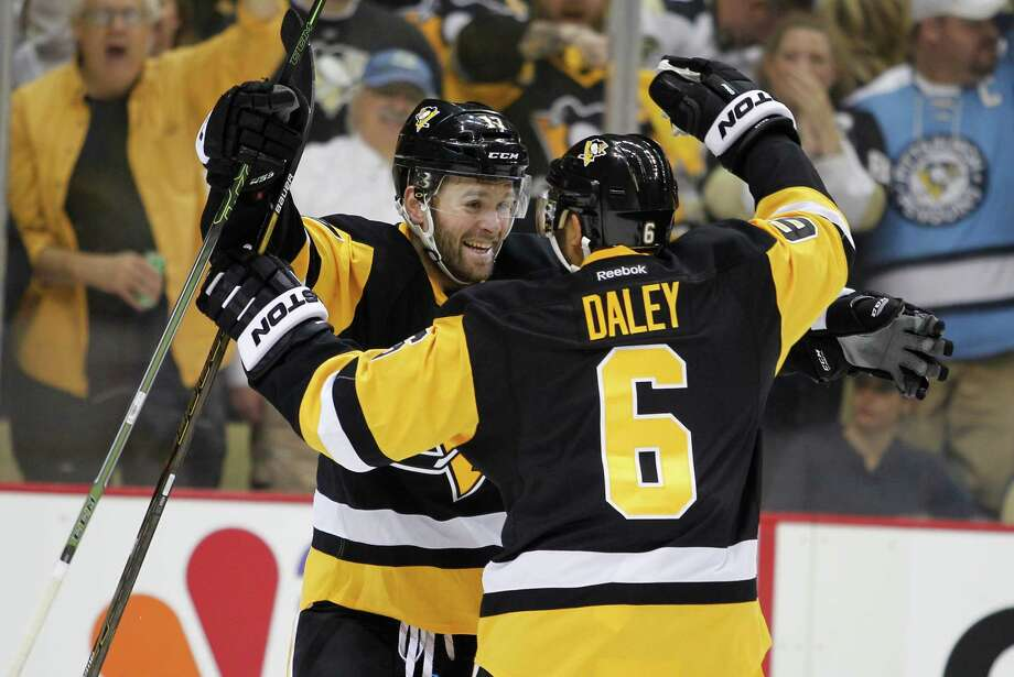 PITTSBURGH, PA - APRIL 23:  Bryan Rust #17 of the Pittsburgh Penguins celebrates his second period goal with Trevor Daley #6 in Game Five of the Eastern Conference First Round against the New York Rangers during the 2016 NHL Stanley Cup Playoffs at Consol Energy Center on April 23, 2016 in Pittsburgh, Pennsylvania.  (Photo by Justin K. Aller/Getty Images) ORG XMIT: 629101241 Photo: Justin K. Aller / 2016 Getty Images