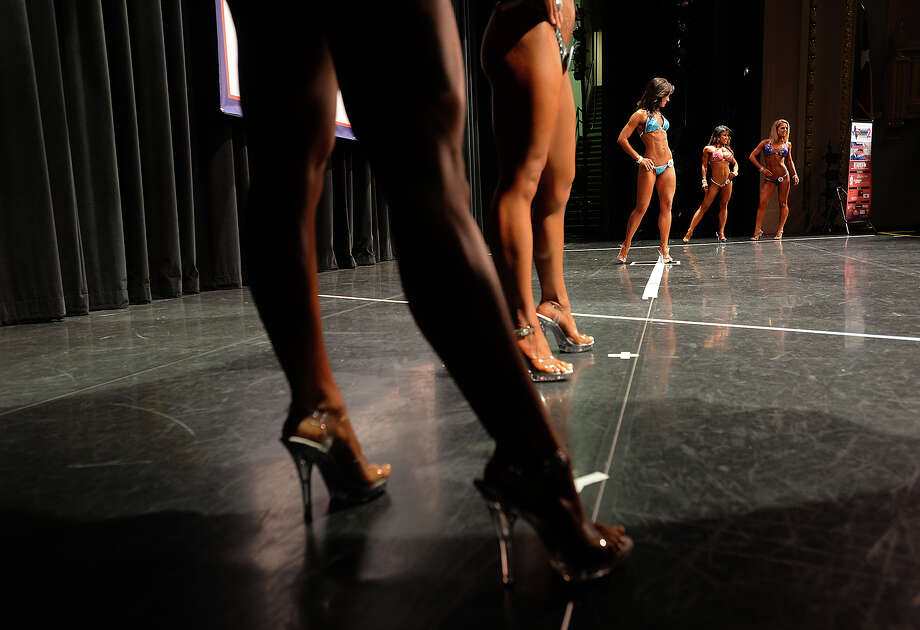 Women take their turns posing onstage during the morning portion of Saturday's Southeast Texas Championship at the Julie Rogers Theatre. The National Physique Committee's event is the first body building, fitness and physique competition to hit Beaumont since 1996. Photo taken Saturday, April 23, 2016 Kim Brent/The Enterprise Photo: Kim Brent / Beaumont Enterprise