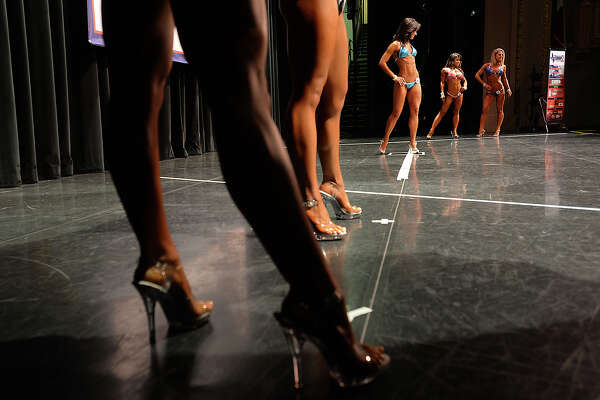 Women take their turns posing onstage during the morning portion of Saturday's Southeast Texas Championship at the Julie Rogers Theatre. The National Physique Committee's event is the first body building, fitness and physique competition to hit Beaumont since 1996. Photo taken Saturday, April 23, 2016 Kim Brent/The Enterprise