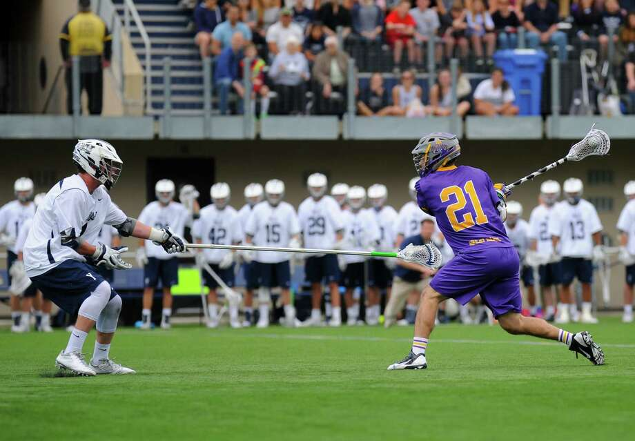 UAlbany's Seth Oakes winds up for the game-winning shot in overtime in the Danes' 14-13 victory over Yale on Saturday, April 23, 2016, in New Haven, Conn. (Gregory Vasil / Special to the Times Union)