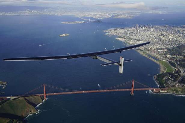 """SAN FRANCISCO - APRIL 23: """"Solar Impulse 2"""", a solar powered plane piloted by Swiss adventurer Bertrand Piccard, is flying over the Golden Gate bridge in San Francisco, California on  April 23, 2016, after a flight from Hawaii, where he took off on 21-April-2016 for a non-stop three day flight to cover about 3,760 kilometers / 2,336 miles.  (Photo by Jean Revillard-Handout/Getty Images)"""