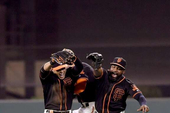 SAN FRANCISCO, CA - APRIL 23:  (L-R) Gregor Blanco #7, Hunter Pence #8 and Denard Span #2 of the San Francisco Giants celebrates defeating the Miami Marlins 7-2 at AT&T Park on April 23, 2016 in San Francisco, California.  (Photo by Thearon W. Henderson/Getty Images)