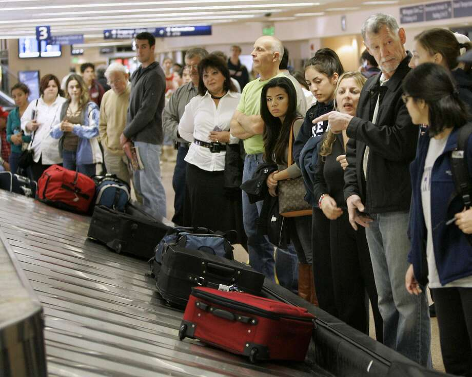 There are so many things that could be improved about air travel, but passengers seem stuck whining about the checked-luggage fee, something that was long overdue. Photo: Marcio Jose Sanchez, AP